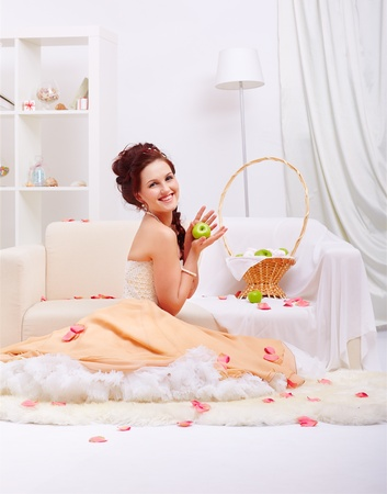 full-length portrait of young beautiful retro woman in vintage skirt with petticoat posing in vintage falt with rose petals around photo