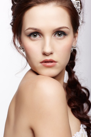 portrait of young beautiful woman with healthy skin looking over her shoulder Stock Photo - 12341996