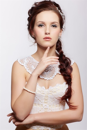 portrait of young beautiful retro woman in vintage corset and accessories photo