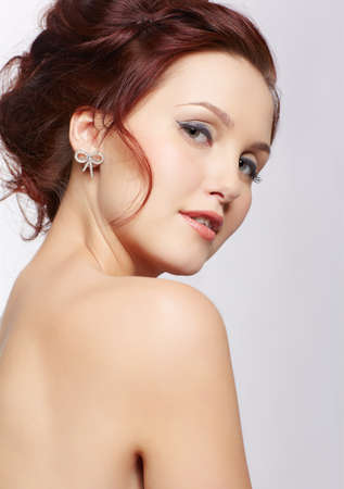 portrait of young beautiful woman with healthy skin looking over her shoulder photo