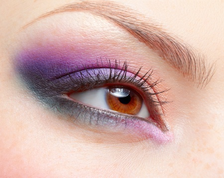 close-up portrait of young beautiful womans eye zone make-up photo