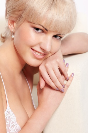 portrait of beautiful smiling young blonde woman in lingerie photo
