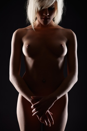 naked silhouette: portrait of young blonde woman with beautiful body