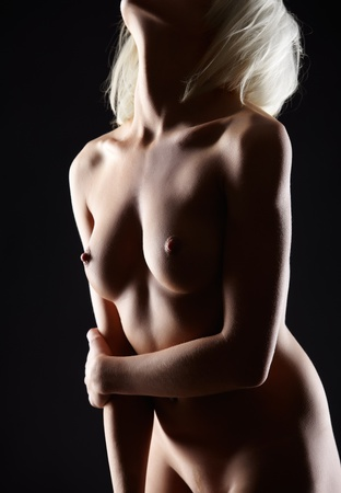 nude blonde girl: body part portrait of young blonde woman with beautiful breasts