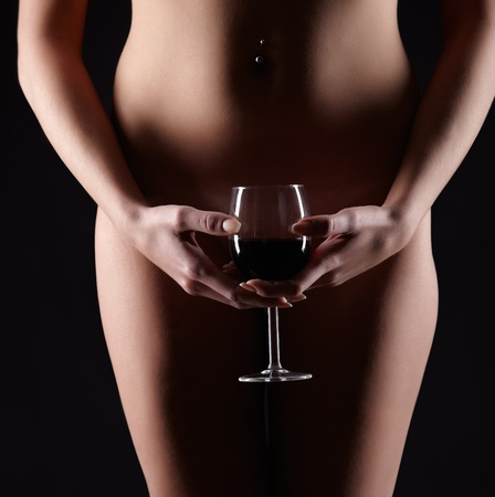 body part portrait of young woman with beautiful body with glass of red wine in hands Stock Photo - 12670634