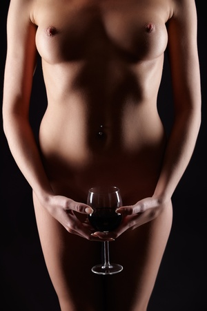 body part portrait of young woman with beautiful breasts with glass of red wine in hand Stock Photo - 12670806
