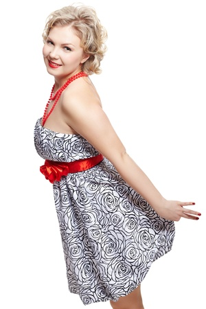 curvy: isolated portrait of beautiful happy young blonde size plus woman model in dress and red beads and belt