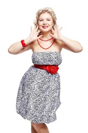 plus size woman: isolated portrait of beautiful happy young blonde size plus woman model in dress and red bracelet, beads and belt Stock Photo