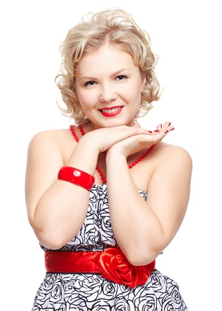 isolated portrait of beautiful happy young blonde size plus woman model in dress and red beads, bracelet and belt photo