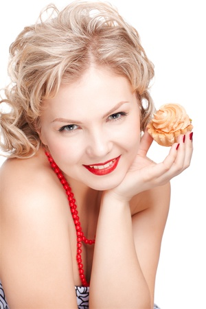 isolated portrait of beautiful happy young blonde size plus woman model with tasty cream tart in hand photo