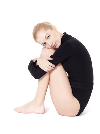 girl sit: isolated portrait of beautiful young blonde woman gymnast Stock Photo