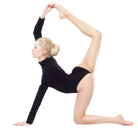 the gymnast: isolated portrait of beautiful young blonde woman gymnast training stretching