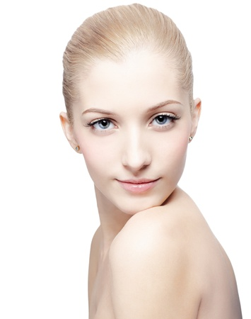 isolated portrait of beautiful young blonde woman looking over shoulder
