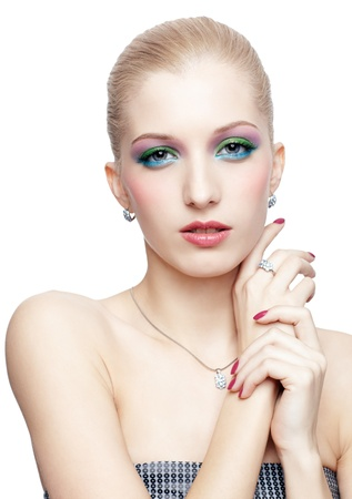 isolated portrait of beautiful young blonde woman in ear-rings, ring and pendant with manicured hands photo