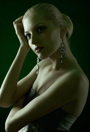 green toned portrait of beautiful young blonde woman in ear-rings Stock Photo - 12841874