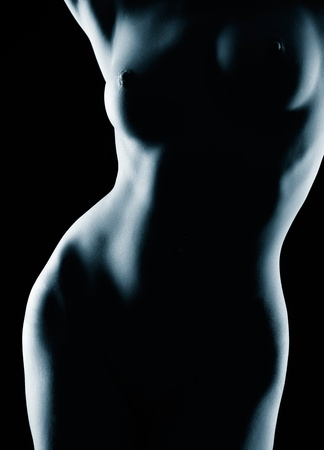 bare breasts: body part portrait of young bare woman with beautiful body