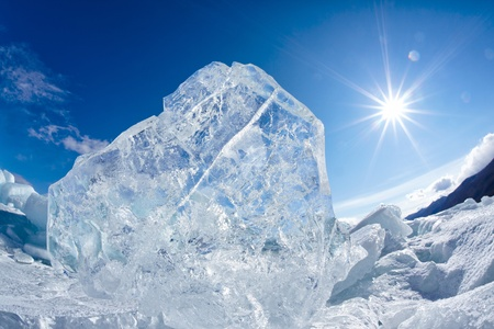 Ice floe and sun on winter Baikal lake photo