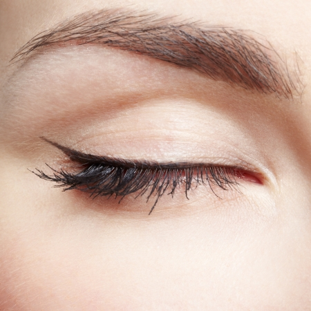close-up portrait of young beautiful womans eye zone make up photo