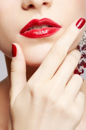 close-up body part portrait of young beautiful woman with manicured fingers photo