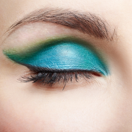 closeup portrait of young beautiful woman eye zone make up
