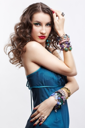portrait of young beautiful brunette woman in blue dress and jewelery Stock Photo