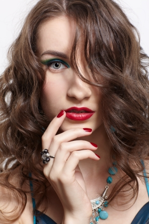 headshot portrait of young beautiful brunette woman in jewellery photo