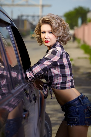 outdoor portrait of young beautiful blonde woman hitchhiker photo