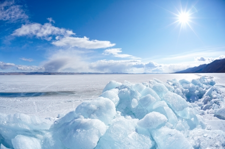 frozen lake: Ice floe and sun on winter Baikal lake