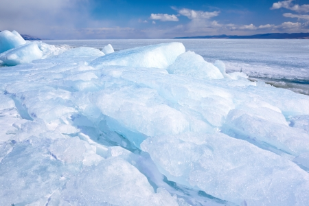 frozen lake: outdoor view of ice blocks at frozen baikal lake in winter