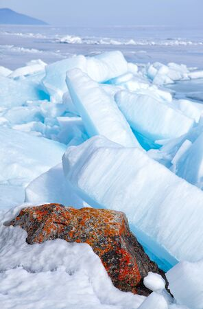 outdoor view of ice blocks at frozen baikal lake in winter photo
