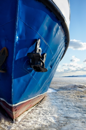 winter view of ship at frozen baikal lake photo