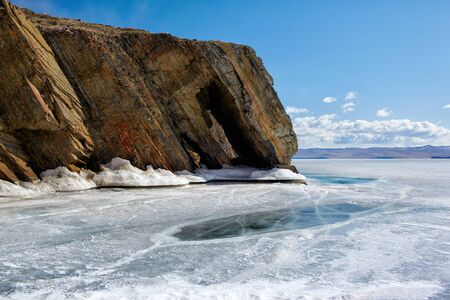 outdoor view of coastal cliffs at frozen baikal lake in winter photo