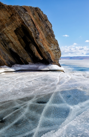 interstice: outdoor view of coastal cliffs at frozen baikal lake in winter