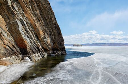 outdoor view of cliffs at frozen baikal lake in winter photo