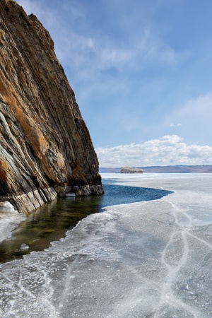 interstice: outdoor view of cliffs at frozen baikal lake in winter