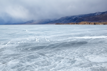 water frozen: outdoor view of frozen baikal lake in winter