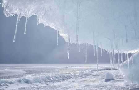 baikal: outdoor view of frozen baikal lake in winter with icicles on foreground