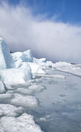 outdoor view of blocks of ice at frozen baikal lake in winter photo