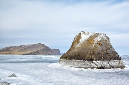 outdoor view of rocks in frozen baikal lake in winter photo