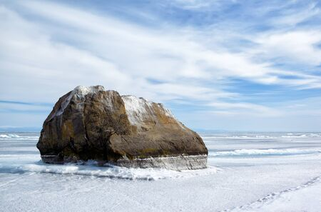 outdoor view of rock in frozen baikal lake in winter Stock Photo - 15189890