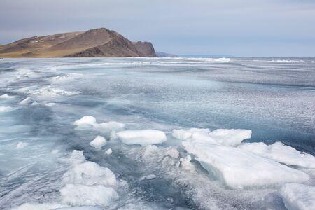 outdoor view of rock in frozen baikal lake in winter