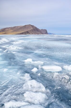outdoor view of rock in frozen baikal lake in winter photo