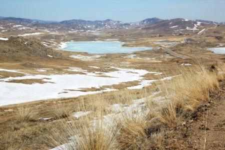 russia steppe: Road in Siberian landscape near lake Baikal  Stock Photo