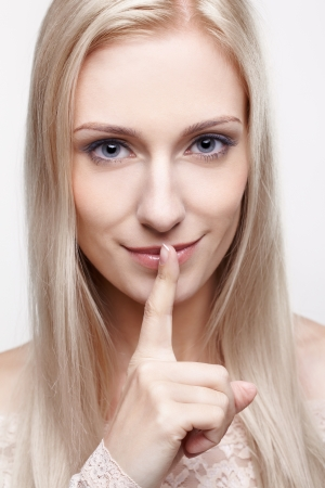 headshot portrait of young beautiful blonde woman asking to be silent Stock Photo - 14916448