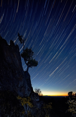 altay: Night scene with startrails and rock in Altay on mountain pass Seminskii Stock Photo