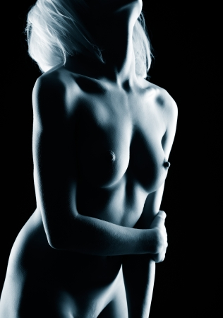 nude blonde woman: body part portrait of young nude blonde woman with beautiful breasts