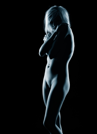 nude blonde woman: portrait of young nude  blonde woman with beautiful body embracing her shoulders
