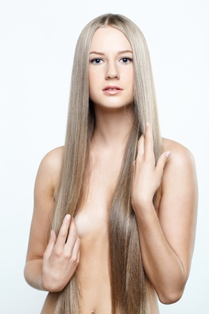 Young beautiful woman with long blond hairs photo