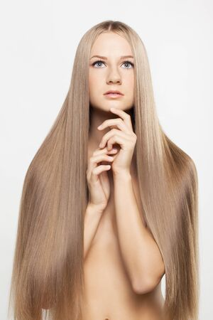 Portrait of beautiful young woman with long blond hair Stock Photo - 15719244