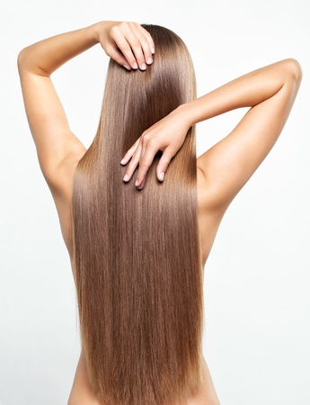 Portrait of beautiful young woman with long healthy hair Stock Photo